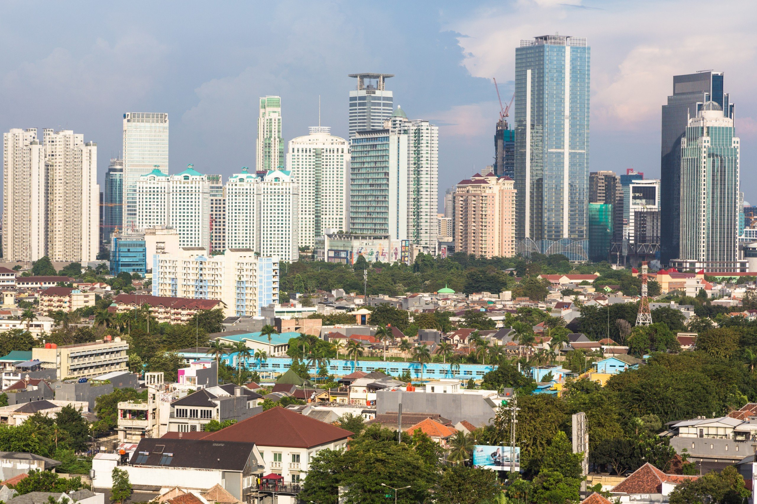 Jakarta, Indonesia capital city, modern buildings with villages like housing structure right in the centre of the city
