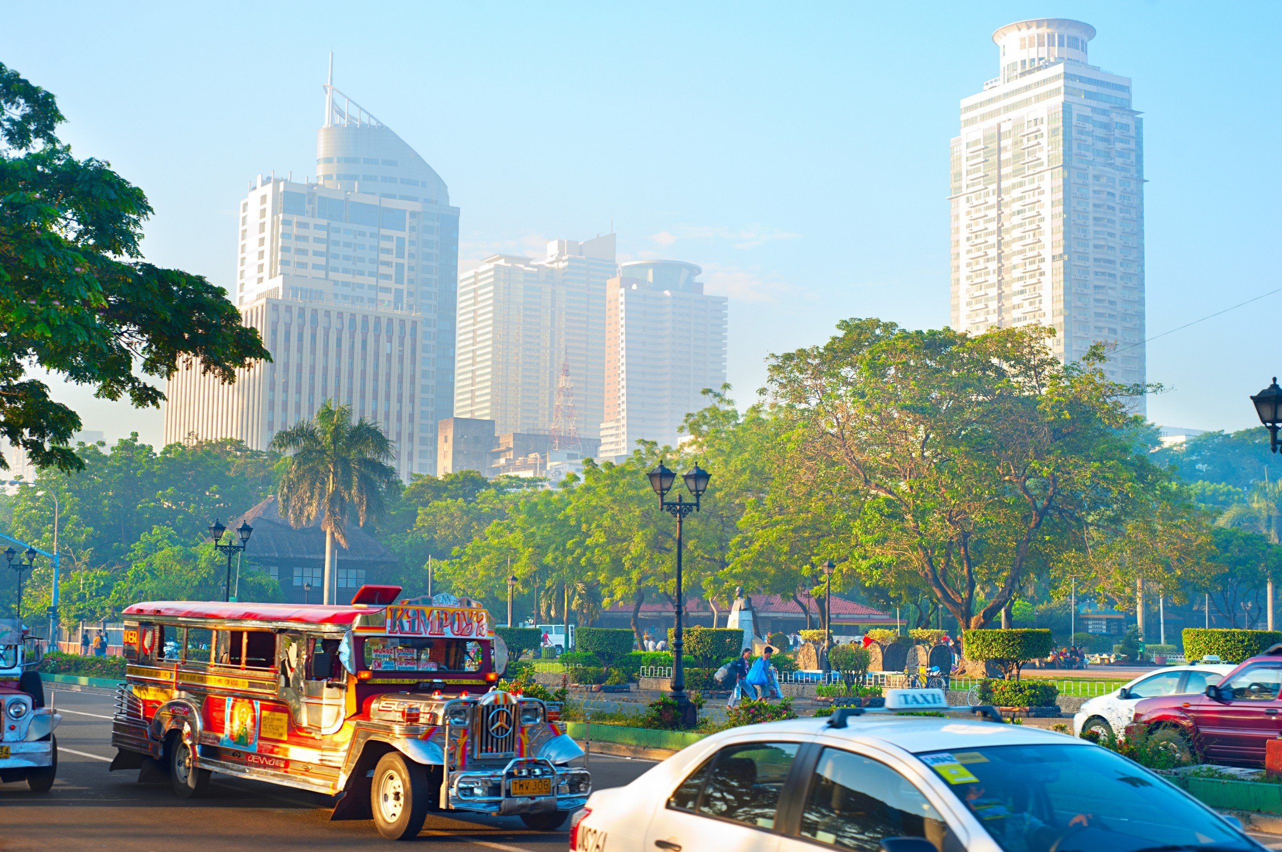 Metro Manila picture with traffic and skyscrapers in background